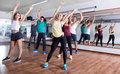 Happy adults having group fitness class