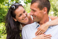 Happy affectionate young couple hugging in park portrait of Royalty Free Stock Photos