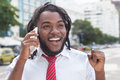 Happy african american businessman with dreadlocks at phone Royalty Free Stock Photo
