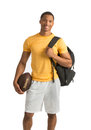 Happy african american college student isolated holding football on white background Stock Image