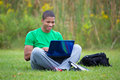 Happy african american college student study outdoor holding laptop studying Royalty Free Stock Images