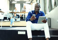 Happy african american entrepreneur using tablet computer. Royalty Free Stock Photo