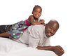 Happy african american father with baby girl on back white background Royalty Free Stock Photography