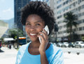 Happy african american girl with cell phone Royalty Free Stock Photo