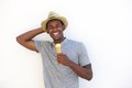 Happy african american guy enjoying ice cream cone Royalty Free Stock Photo