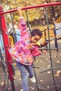 Happy African liitle girl in playground. Royalty Free Stock Photo