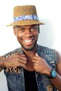 Happy african american male fashion model with hat Royalty Free Stock Photo