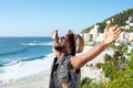 Happy african american man with arms outstretched portrait of a by the beach Stock Images