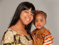 Happy African American Mother Holding Baby Girl Royalty Free Stock Photo