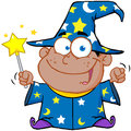 Happy african american wizard boy waving magic wand Royalty Free Stock Image