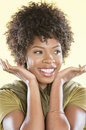 Happy African American woman looking away over colored background Royalty Free Stock Photos