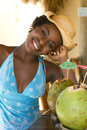 Happy African American woman at tiki bar Stock Photos