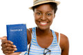 Happy african american woman tourist holding passport white background Royalty Free Stock Photography