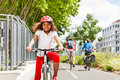 Happy African girl cycling on bicycle path in city Royalty Free Stock Photo