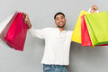 Happy african man holding shopping bags. Royalty Free Stock Photo