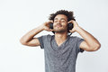 Happy african man smiling listening to music in headphones. Closed eyes. Royalty Free Stock Photo