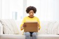 Happy african young woman with parcel box at home Royalty Free Stock Photo