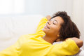 Happy african young woman relaxing at home people rest comfort and leisure concept or dreaming Royalty Free Stock Photography