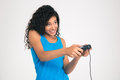 Happy afro american woman playing in video game with joystick