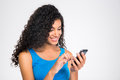 Happy afro american woman using smartphone Royalty Free Stock Photo