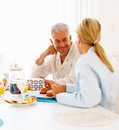 Happy aged couple having a healthy breakfast Royalty Free Stock Images