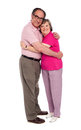 Happy aged woman hugging her husband Royalty Free Stock Images