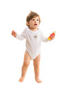 Happy amazed toddler boy full length of walking barefoot and looking to soap bubbles Royalty Free Stock Image