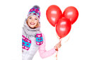 Happy american woman with red balloons and banner looks from isolated on white background Stock Photo