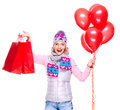 Happy american woman with red shopping bags and balloons isolated on white background Royalty Free Stock Photos