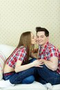 Happy amorous couple girl kissing her boyfriend while he looking at camera Stock Photos