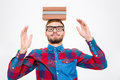 Happy amusing man in glasses with books on his head Royalty Free Stock Photo
