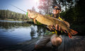 Happy angler with pike Royalty Free Stock Photo