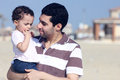 Happy arab egyptian father holding his daughter Royalty Free Stock Photo