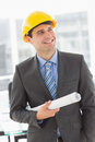Happy architect smiling and holding blueprints Royalty Free Stock Photo