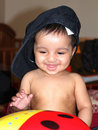 Happy Asian baby girl wearing fathers hat Stock Image