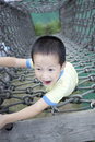 Happy asian boy climb sport in adventure park the Royalty Free Stock Photos