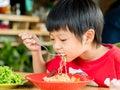 Happy Asian boy eating Royalty Free Stock Photo