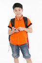 Happy asian boy using cell phone . Royalty Free Stock Photo