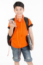 Happy asian boy using cellphone and holding laptop . Royalty Free Stock Photo