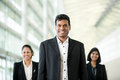 Happy Asian business man with colleagues. Stock Photo
