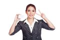 Happy Asian businesswoman show victory sign and bl Royalty Free Stock Photo