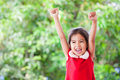 Happy asian child girl in christmas dress raising her hands Royalty Free Stock Photo