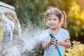 Happy asian child girl help parent washing car Royalty Free Stock Photo