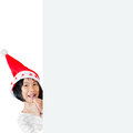 Happy Asian child wearing santa hat with white Royalty Free Stock Photo