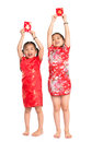 Happy asian children holding red packet during chinese new year with traditional cheongsam full length standing isolated on white Royalty Free Stock Image