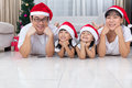 Happy Asian Chinese family lying on the floor celebrating Christ