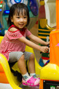 Happy asian chinese gril girl at indoor playground Stock Photography
