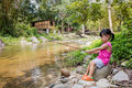 Happy Asian Chinese little girl angling with fishing rod Royalty Free Stock Photo