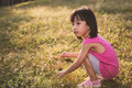 Happy Asian Chinese Little Girl Picking Wild Flowers Royalty Free Stock Photo