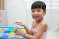 Happy Asian Chinese little girl playing kinetic sand at home Royalty Free Stock Photo